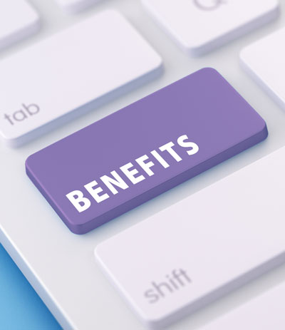 "Close-up of keyboard with purple highlighted key that reads ""BENEFITS"""