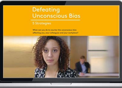 "Laptop screen showing ""Defeating Unconscious Bias"" eLearning"